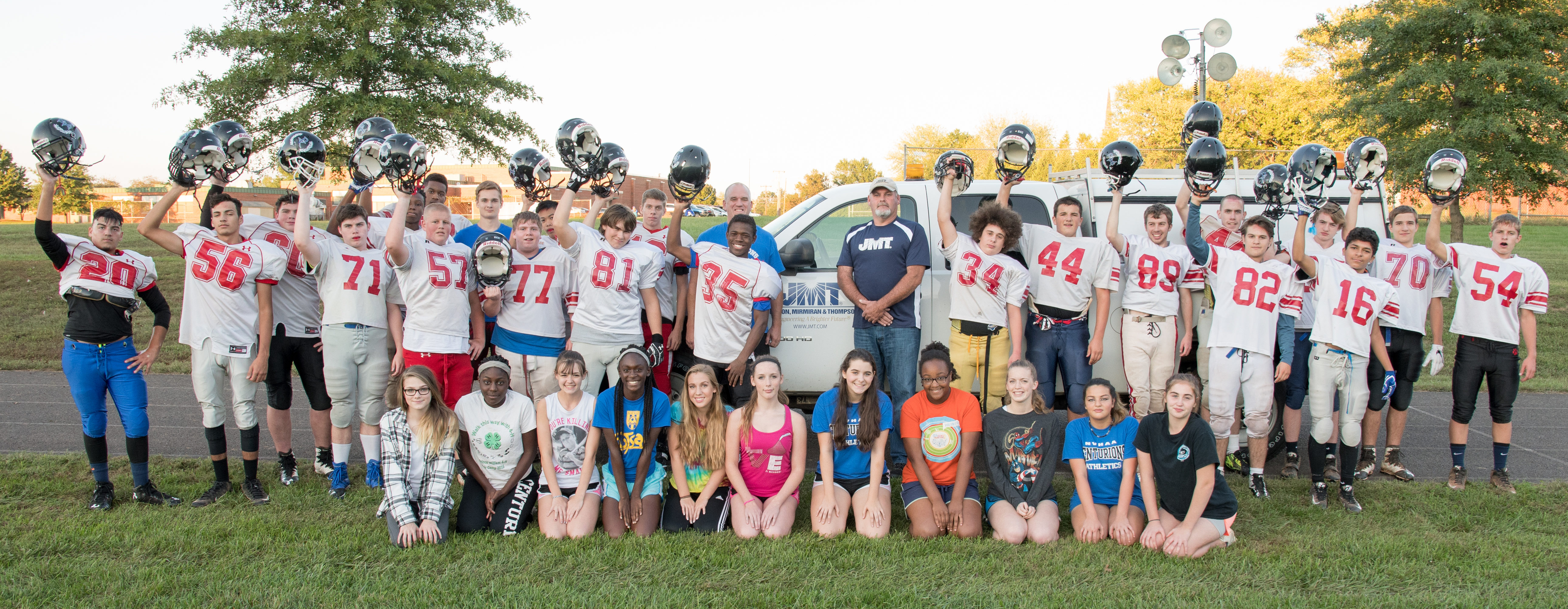 JMT Surveyor and Truck with the 2016 football and cheerleading teams.
